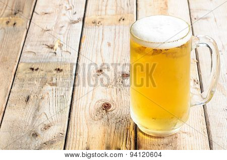 beer mug on wooden table background