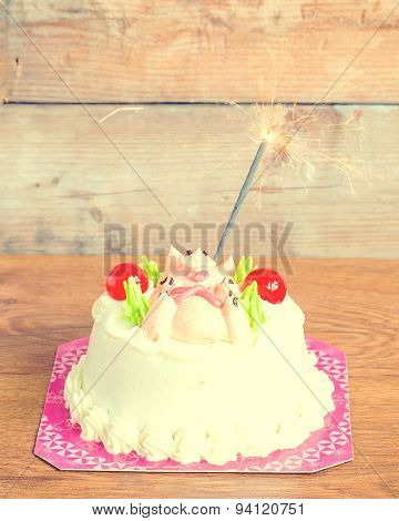 birthday cake with lots of candles on a wooden background