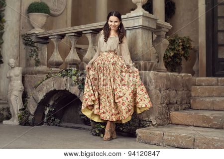 Young Beautiful Woman In Flower Skirt