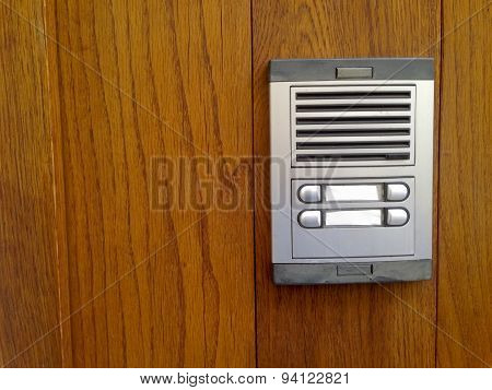Old Intercom Over Wooden Door
