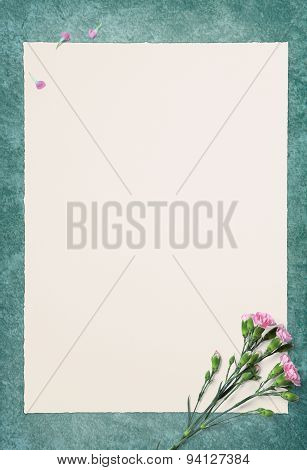 Empty White Paper And Pink Carnation On Green Floor