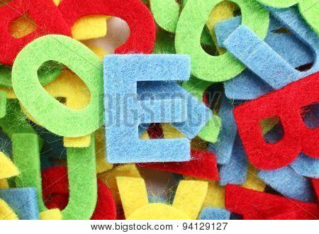 Colorful cut letters for textile decoration