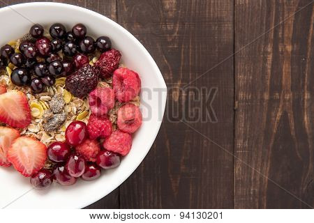 Oatmeal In Bowl Topped With Fresh Blueberries, Cranberries, Strawberries, Raspberries, Blackberries