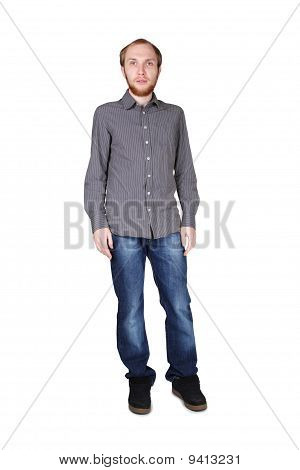 Young Man With Beard In Grey Shirt And Jeans Standing Isolated On White