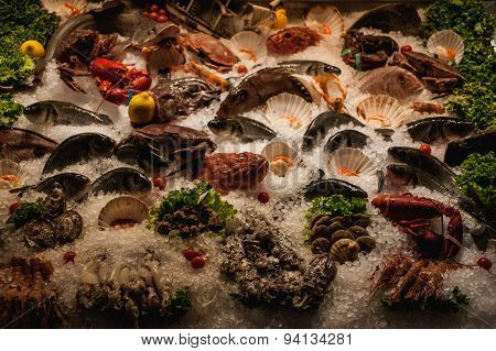 Seafood Displayed On Ice In Front Of Restaurant
