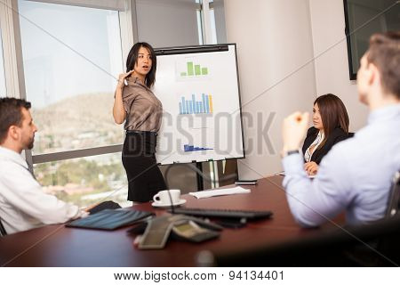 Latin Businesswoman In A Meeting