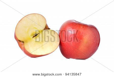 Whole And Half Cut Red Apples With Stem On White Background