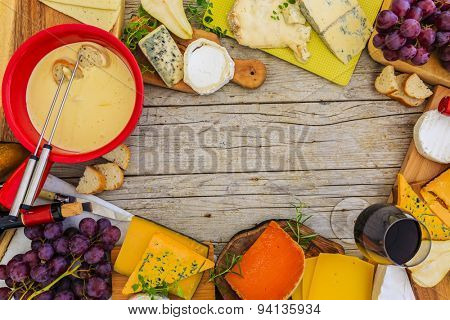 Cheese, fondue cheese - different types of cheese on a wooden background