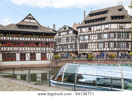 STRASBOURG, FRANCE - SEPTEMBER 26 2008: Strasbourg, water canal in Petite France area. timbered hous