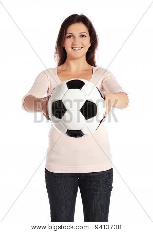 young woman holding a soccer ball