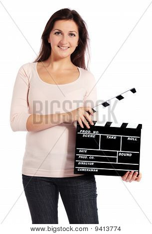 Young woman holding a clapperboard
