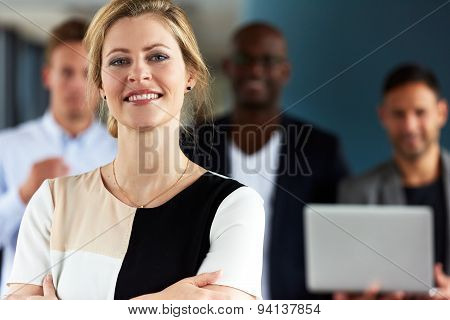 White Female Executive Facing Camera With Arms Crossed