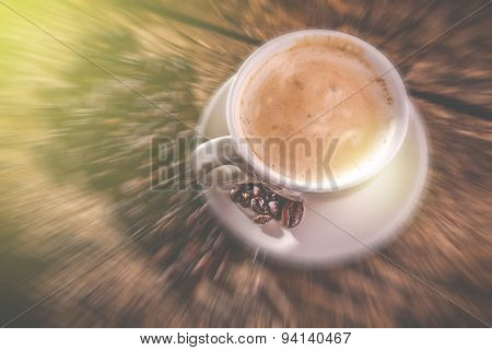 Morning cappuccino cup - blurred style photo