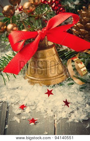 Christmas golden bell with red satin ribbon bow