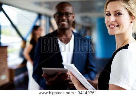 Black Executive And White Executive Smiling At Camera
