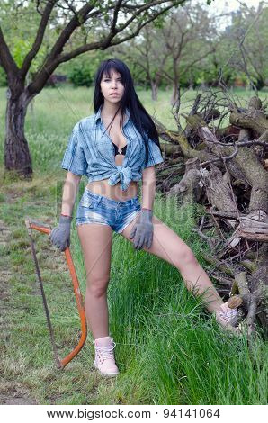 Beautiful Sexy Girl Cutting Wood In Orchard In Spring