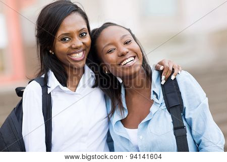 happy young afro american female college friends on campus