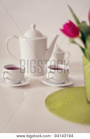Beautiful white porcelain tea service on table
