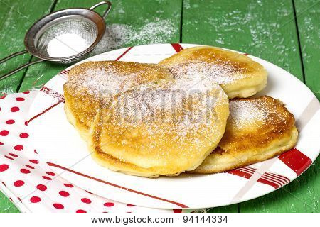 Traditional Russian Fritter With Powdered Sugar