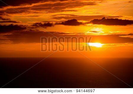 Sunset on sea, bright sun on sky