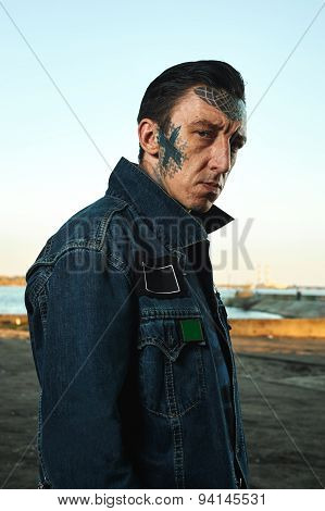 Fashion Portrait Of Serious Man With Tattooed Face