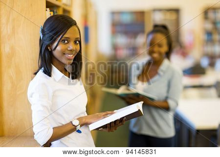happy african university student in reading a book