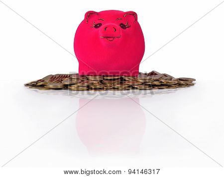 Piggy Bank On The Piles Of Gold Coins On A White