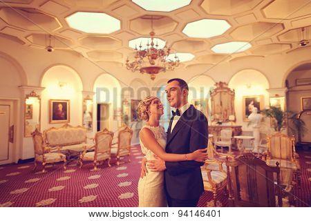 Bride And Groom Dancing In Empty Restaurant
