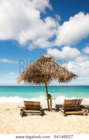 Beach chairs and sunshade on a beautiful island