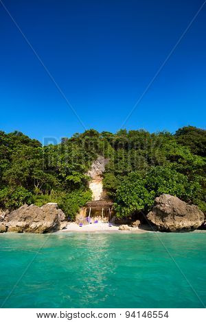 view of the beach from the sea, small hidden tropical beach