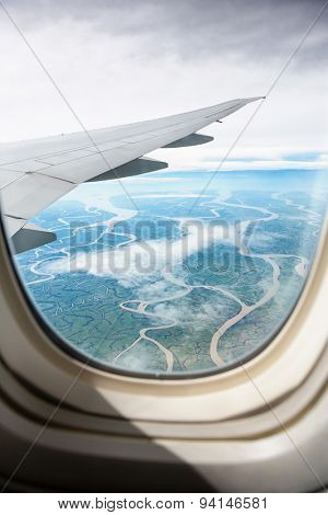 view from jet plane window on land, beautiful  look on river