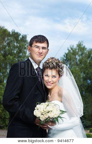 newlyweds against blue sky