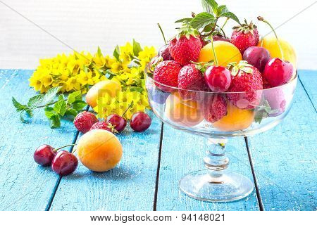 Lots Of Strawberries, Cherries And Apricots In A Vintage Glass Vase