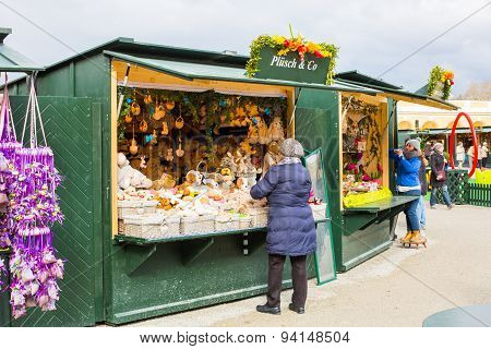 Sellers preparing different goods for selling at the Easter market in Vienna