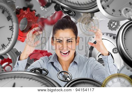 Furious businesswoman gesturing against grey background with vignette
