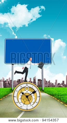 Happy businessman leaping with his briefcase against road leading out to the horizon