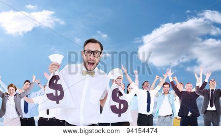Geeky businessman holding money bags against sky and clouds