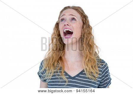 Pretty blonde standing and screaming on white background