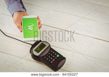 Payment screen against man using smartphone to express pay