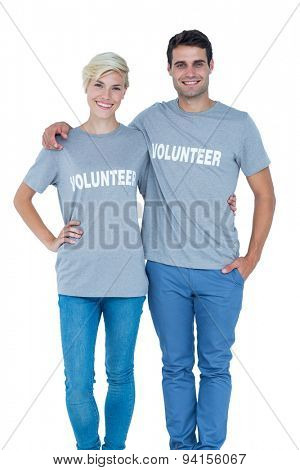 Cute couple of young volunteers holding themselves