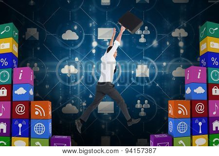 Businessman leaping with his briefcase against app wall