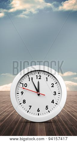 countdown to midnight on clock against wooden planks leading to blue sky