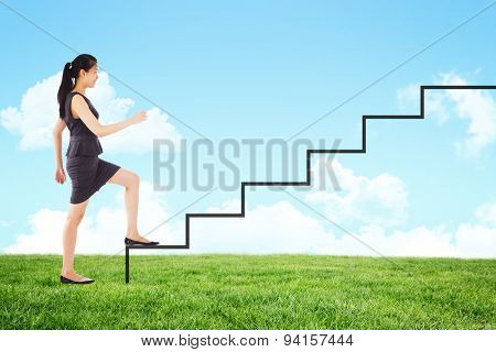 Businesswoman stepping up against blue sky over green field
