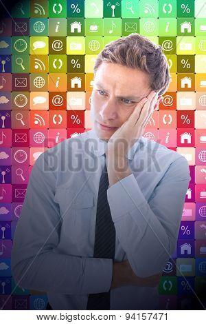 Upset thinking businessman against app wall