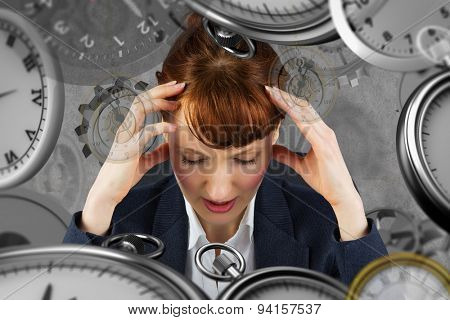Stressed businesswoman against grey background
