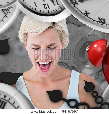 Angry blonde yelling with hands up against grey background