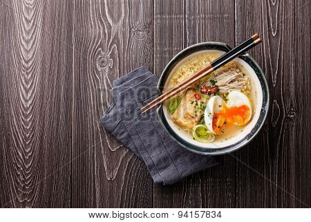 Asian Noodles With Egg, Tofu And Enoki In Bowl On Gray Wooden Background