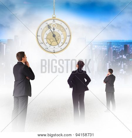 Businessman standing and looking against mirror image of city skyline