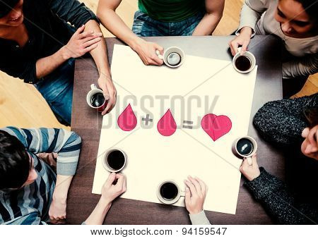 People sitting around table drinking coffee against blood donation