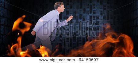 Stepping businessman against dark grey room